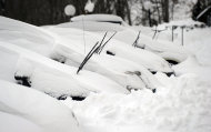 Snow covers cars in a parking lot at a condominium complex in Danbury, Conn. Saturday morning, Feb. 9, 2013. A behemoth storm packing hurricane-force wind gusts and blizzard conditions swept through the Northeast overnight. (AP Photo/The News-Times, Carol Kaliff) MANDATORY CREDIT: THE NEWS-TIMES, CAROL KALIFF