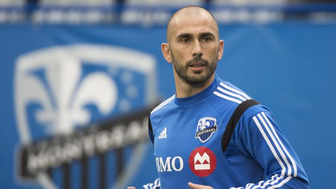 Montreal Impact's Marco Di Vaio, of Italy, warms up prior to his final MLS career game against D.C. United in Montreal, Saturday, Oct. 25, 2014. (AP Photo/The Canadian Press, Graham Hughes)