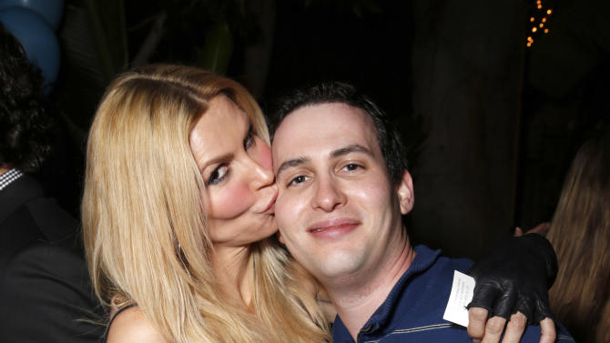 Brandi Glanville and The Real Housewives of Beverly Hills Producer Alex Baskin attend Darin Harvey's 50th Birthday Party at Sur Restaurant, on Saturday March 30, 2013 in Los Angeles.(Photo by Todd Williamson/Invision/AP)