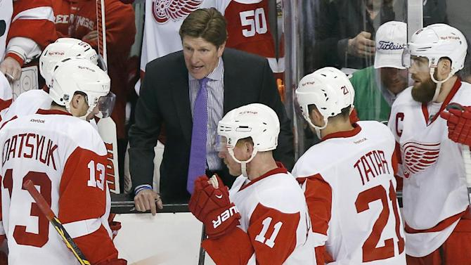 Detroit Red Wings head coach Mike Babcock talks with his team during a timeout in the third period against the Boston Bruins  in Game 5 in the first round of the NHL hockey Stanley Cup playoffs in Boston, Saturday, April 26, 2014. Boston won 4-2 and eliminated the Red Wings from the playoffs