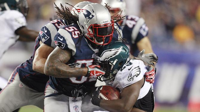 New England Patriots linebacker Brandon Spikes (55) tackles Philadelphia Eagles running back LeSean McCoy (25) during the second quarter of an NFL preseason football game in Foxborough, Mass., Monday, Aug. 20, 2012.(AP Photo/Steven Senne)