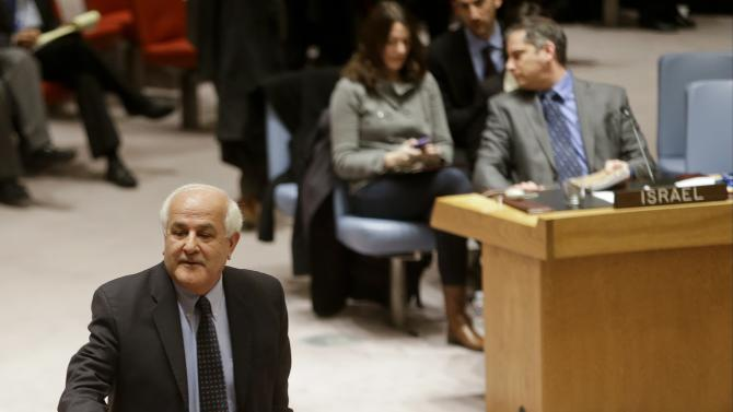 Palestinian Ambassador to the United Nations Riyad Mansour, left, goes to shake hands with members after a meeting of the U.N. Security Council, Tuesday, Dec. 30, 2014, at the United Nations headquarters. The United Nations Security Council has rejected a Palestinian resolution demanding an end to Israeli occupation within three years on Tuesday. (AP Photo/Frank Franklin II)