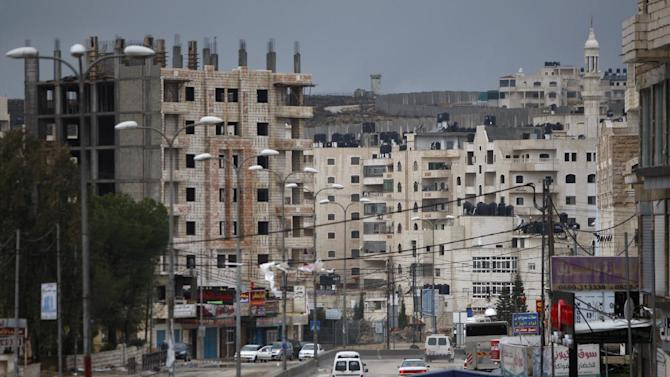 In this photograph taken Jan. 9, 2013, a general view of the Kufr Aqab Jerusalem neighborhood is seen. Kufr Aqab is one of several Arab areas within Jerusalem's municipal borders that have been separated from the city by the security barrier Israel has built to wall off the West Bank. (AP Photo/Majdi Mohammed)