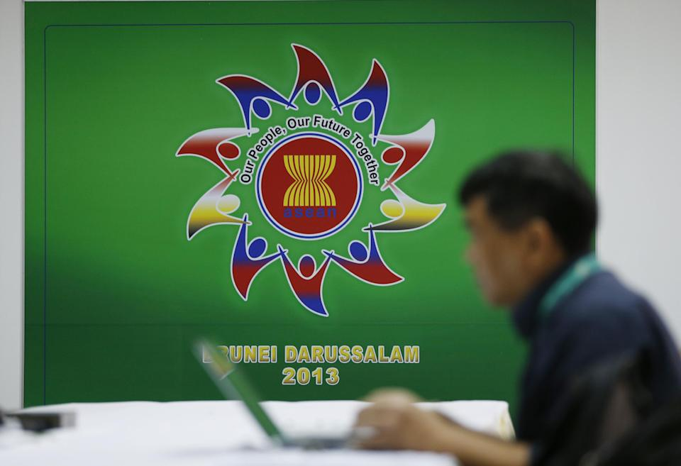 A reporter works in media room at Bandar Seri Begawan Brunei, Friday, June 28, 2013. Foreign Ministers from ASEAN countries gather in Brunei for the 46th ASEAN Foreign Minister Meeting starting June 29. (AP Photo/Vincent Thian)