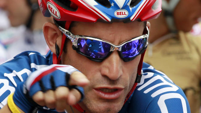 """FILE - In this July 17, 2010 file photo, George Hincapie of the US, points as he talks to other riders prior to the 13th stage of the Tour de France cycling race in Rodez, France. A report by """"60 Minutes"""" says Hincapie, a longtime member of Lance Armstrong's inner circle, has told federal authorities he saw the seven-time Tour de France winner use performance-enhancing drugs. A segment of the report aired Friday night, May 20, 2011 on the """"CBS Evening News.""""  (AP Photo/Bas Czerwinski, File)"""