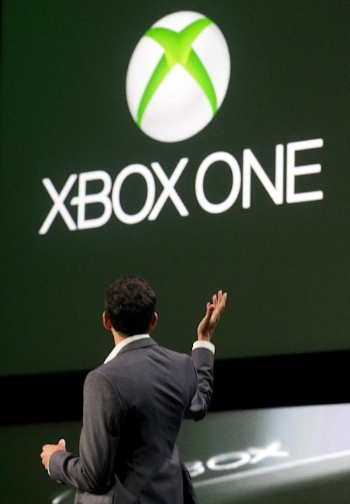 Yusuf Mehdi, Corporate Vice President of Xbox Marketing at Microsoft, introduces Xbox One entertainment offerings during the Xbox Reveal event, on Tuesday, May 21, 2013, in Redmond, Wash. (Photo by St