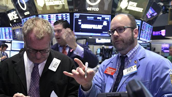 Traders Douglas Glander, left, and Peter Mancuso, right, work on the floor of the New York Stock Exchange Thursday, Dec. 6, 2012.  The U.S. stock market wobbled between small gains and losses in early trading Thursday. (AP Photo/Richard Drew)