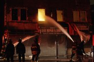 New York City firefighters battle a blaze on Rockaway Beach Boulevard on Tuesday, Oct. 30, 2012, in New York. (AP Photo/Frank Franklin II)