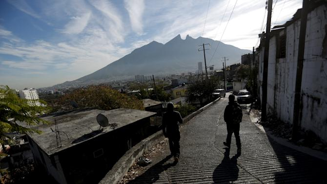 Residents walk toward their homes after a boxing training session at the rough Cerro de la Campana neighbourhood in Monterrey
