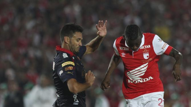 Jefferson Cuero of Colombia's Santafe fights for the ball against Diego Hemer of Colombia's Medellin during the Colombian first division championship in Bogotá