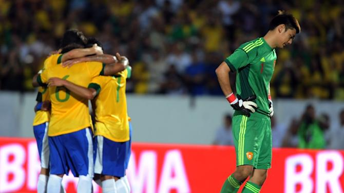 The 28-year-old Cheng Zeng (R) also plays in goal for China, pictured here in a friendly against Brazil in 2012