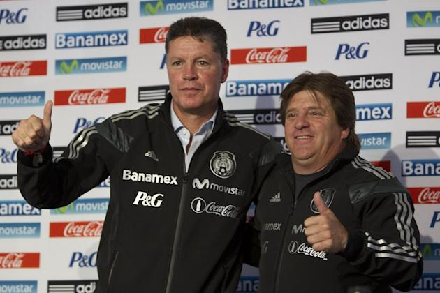 Mexico head coach Miguel Herrera, right and Ricardo Pelaez, Mexico sports director, pose during a press conference at the national team's training center in Mexico City, Friday, Dec. 6, 2013, afte