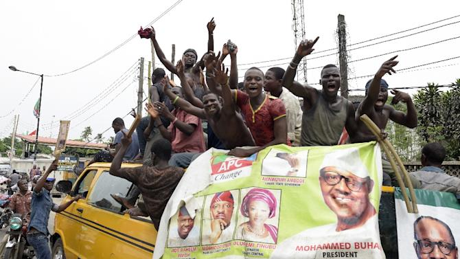 Supporters of President-elect Muhammadu Buhari celebrate his victory in Lagos on April 1, 2015