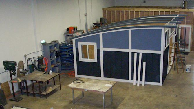 This undated photo provided by Cabin Fever shows a prefabricated backyard studio under construction in Cabin Fever's manufacturing plant in Miami, Fla. The cabin was disassembled after this photo was taken, and shipped to Alpine,Texas, where it was reassembled in the owner's backyard. (AP Photo/Cabin Fever, Tim Walker)