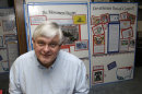 In this May 14, 2013 photo, Tom Zawistowki, founder of the nonprofit Ohio Liberty Coalition, one of the region's largest groups affiliated with the national tea party movement, poses with a binder of documents he gave to the IRS, in Kent, Ohio. For years, Ohio Liberty Coalition would raise thousands of dollars to bus activists to rallies, run phone banks, rent a tent at a local fair, and knock on roughly 40,000 doors across Ohio to challenge the president and his fellow Democrats in the 2012 elections. Tea party movement leaders say IRS acknowledgement that it had targeted their groups for extra scrutiny is helping pump new energy into the coalition. (AP Photo/Tony Dejak)