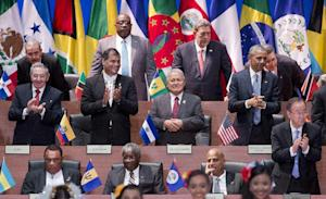 President Barack Obama, right middle row, and Cuba's …