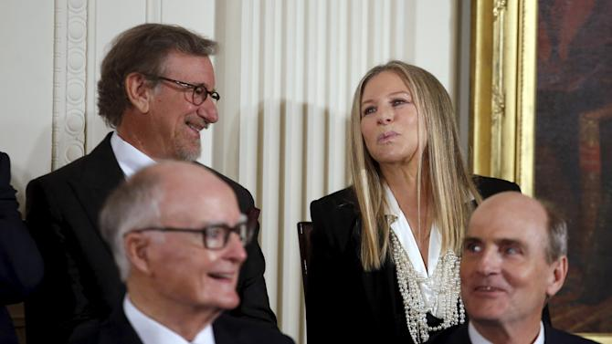 Singer Barbra Streisand blows a kiss to U.S. President Barack Obama before receiving the Presidential Medal of Freedom during an event in the East Room of the White House in Washington