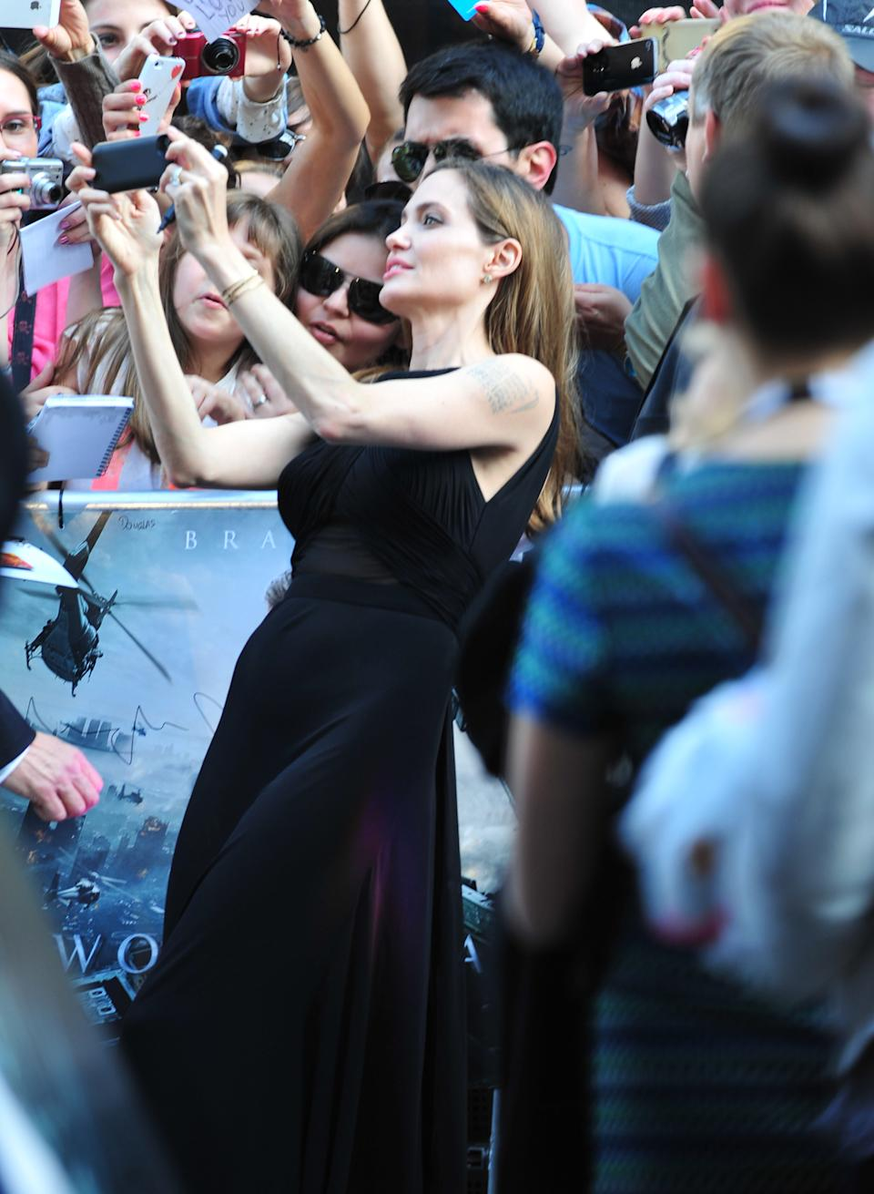Angelina Jolie greets fans at the World Premiere of 'World War Z' at the Empire Cinema in London on Sunday June 2nd, 2013. (Photo by Jon Furniss/Invision/AP Images)