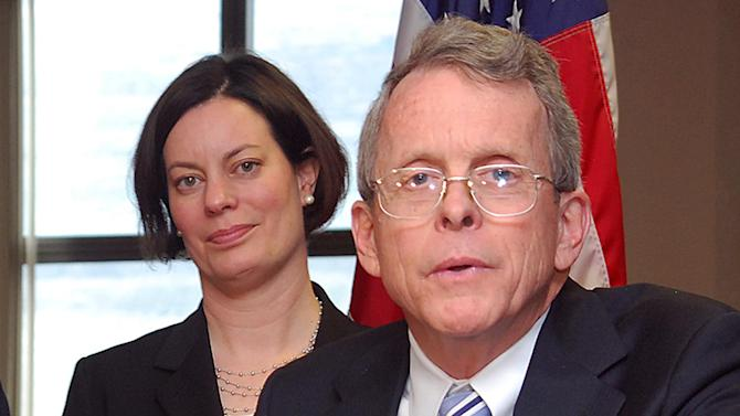 FILE--In this file photo from Sunday, March 17, 2013, Ohio Attorney General Mike DeWine, right, answers questions about the successful prosecution of two juveniles in a rape case during a news conference at the Jefferson County Justice Center in Steubenville, Ohio. DeWine said on Thursday April 25, 2013 that search warrants have been executed at the high school attended by the two football players convicted in this trial. DeWine's office says in a statement that search warrants were also executed Thursday at the Steubenville school board offices and a northeast Ohio digital investigations company. One of the prosecutors from the case Marianne Hemmeter, is seen at left. (AP Photo/Steubenville Herald-Star, Michael D. McElwain, Pool)