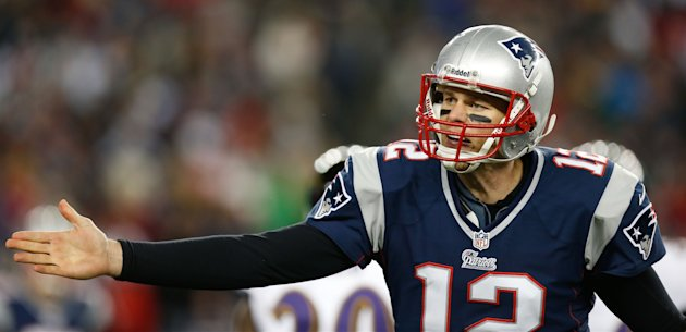 Jan 20, 2013; Foxboro, Massachusetts, USA; New England Patriots quarterback Tom Brady (12) complains to a referee after not being able to convert on a fourth down during the fourth quarter against the Baltimore Ravens at Gillette Stadium. (Greg M. Cooper-USA TODAY Sports)