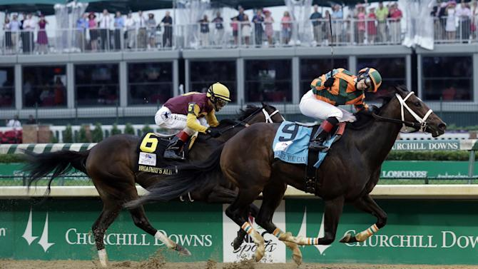 Rosie Napravnik rides Believe You Can to victory in front of Broadway's Alibi (6) ridden by John Velazquez in the 138th running of the Kentucky Oaks horse race at Churchill Downs Friday, May 4, 2012, in Louisville, Ky. (AP Photo/Morry Gash)