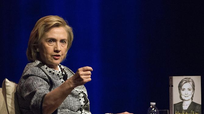 Hillary Rodham Clinton speaks at an event to discuss her new book in Washington, Friday, June 13, 2014. Clinton discussed choices and challenges she faced during her four years as America's 67th Secretary of State, and how these experiences drive her view of the future. (AP Photo/Molly Riley)