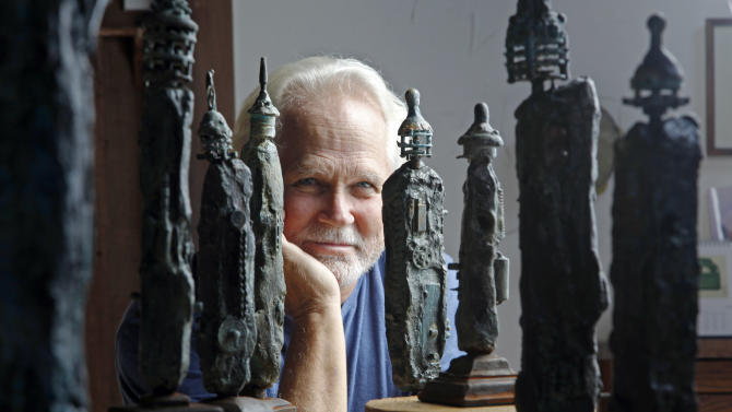 "In this Thursday, Sept. 18, 2012 photo, Tony Dow, actor, director and artist, poses with some of his works at his home and studio in the Topanga area of Los Angeles. When it comes time to sitting down in a studio and carving out bronze and wooden sculptures inspired by the nature all around him, Wally isn't leaving it up to the Beav these days. Dow, who famously played the Beaver's older brother Wally on the classic 1950s-60s sitcom ""Leave it To Beaver,"" is carving out a name for himself in the art world these days, as an abstract artist. (AP Photo/Reed Saxon)"
