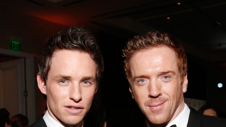 Eddie Redmayne, left, and Damian Lewis are seen during the cocktail reception at the 24th Annual Producers Guild (PGA) Awards at the Beverly Hilton Hotel on Saturday Jan. 26, 2013, in Beverly Hills, Calif. (Photo by Todd Williamson/Invision for The Producers Guild/AP Images)