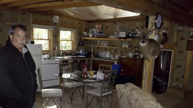 In this photo taken Sept. 30, 2011, Al Grasch is seen in Forkston, Pa., inside the cabin where his son David Grasch and two of David's cousins died under mysterious circumstances in November 2006. Pennsylvania State Police said Tuesday March 20, 2012, that they now believe that carbon monoxide poisoning likely killed the three men, after new tests were conducted in the wake of a story by The Associated Press that raised questions about suspicions it might have been a triple homicide. (AP Photo/Mark Scolforo)