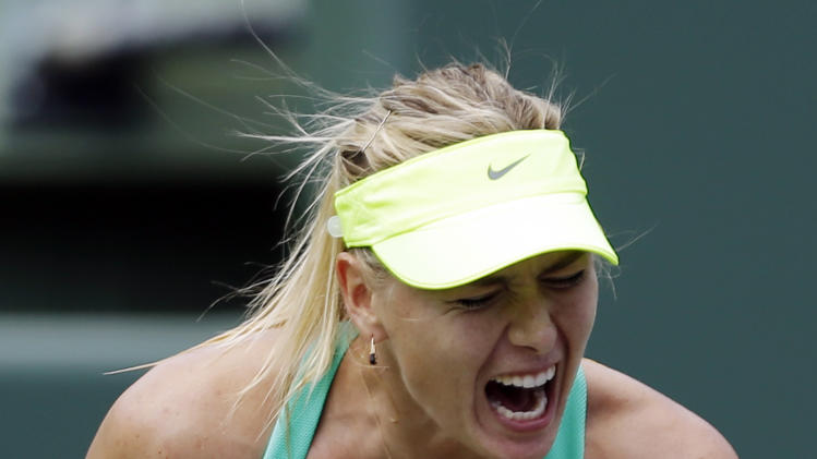 Maria Sharapova, of Russia, reacts after scoring a point against Elena Vesnina, also of Russia, during the Sony Open tennis tournament in Key Biscayne, Fla.,  Sunday, March 24, 2013. (AP Photo/Alan Diaz)