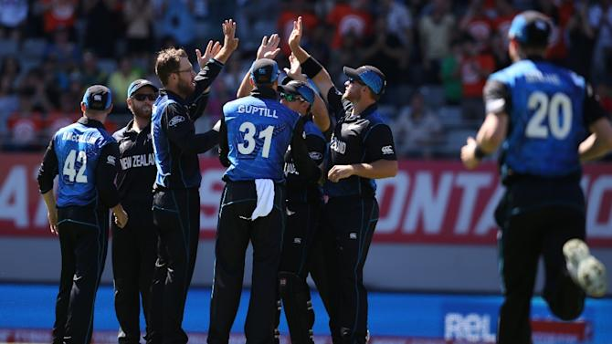 New Zealand's players celebrate the wicket of Steven Smith during their Cricket World Cup Pool A match against Australia, at Eden Park in Auckland, on February 28, 2015