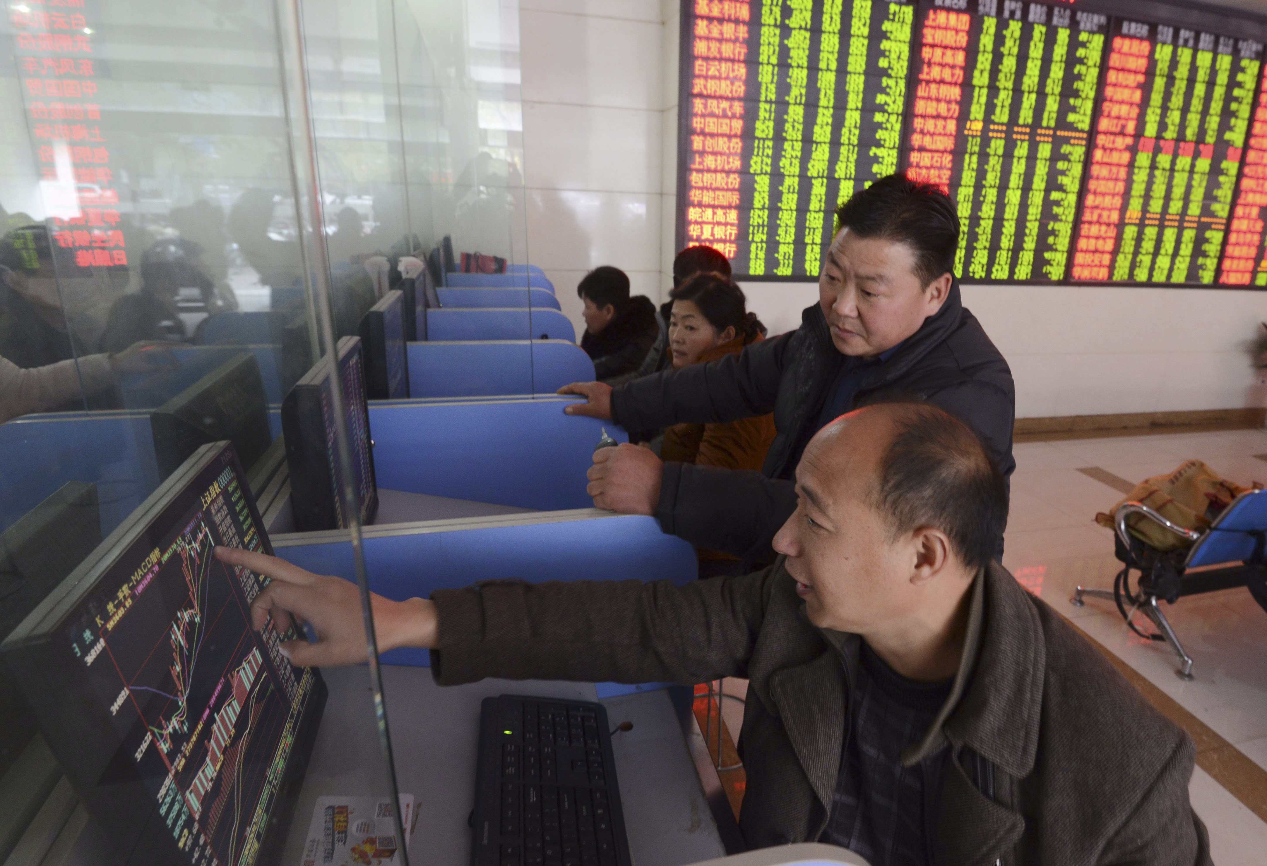 3 Chinese brokerages say they are under investigation