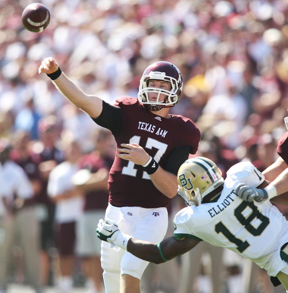 Texas A&M quarterback Ryan Tannehill (17) throws the ball against Baylor defender Tevin Elliott (18) during the first half of an NCAA college football game Saturday, Oct. 15, 2011, in College Station, Texas. (AP Photo/Jon Eilts)