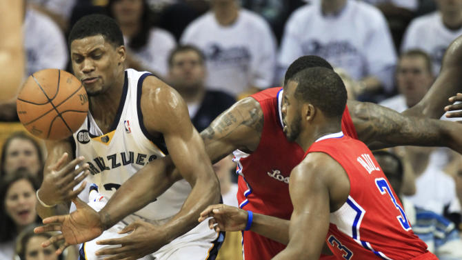 Memphis Grizzlies forward Rudy Gay, left, battles with Los Angeles Clippers center DeAndre Jordan and guard Chris Paul, right, for the ball in the first half of Game 7 in a first-round NBA basketball playoff series on Sunday, May 13, 2012, in Memphis, Tenn. (AP Photo/Mark Humphrey)