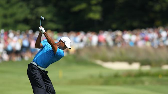 Tiger Woods hits his second shot on the second hole during the second round of the Deutsche Bank Championship PGA golf tournament at TPC Boston in Norton, Mass., Saturday, Sept. 1, 2012. (AP Photo/Stew Milne)