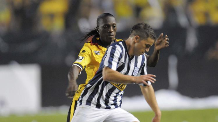 Gabriel Costa (R) of Peru's Alianza Lima carries the ball under pressure from Geovanny Nazareno of Ecuador's Barcelona during their Copa Sudamericana soccer match at the Monumental stadium in Guayaquil
