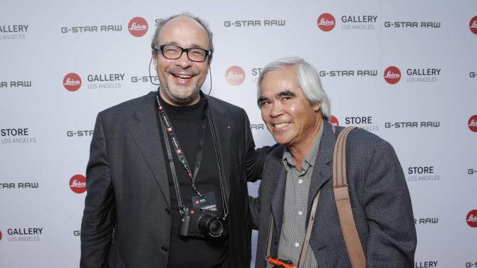 IMAGE DISTRIBUTED FOR LEICA - Leica Deputy Chairmain of the Supervisory Board Dr. Andreas Kaufmann, left, and AP photographer Nick Ut attend the Leica Los Angeles Grand Opening, on Thursday, June 20, 2013 in West Hollywood, California. (Photo by Todd Williamson/Invision for Leica/AP Images)