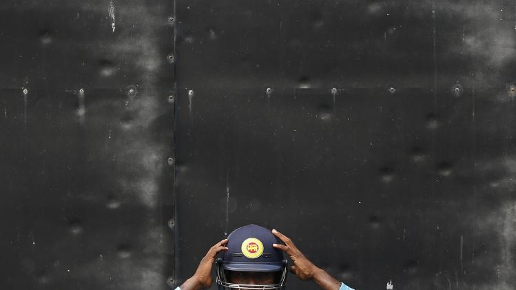 Sri Lanka's captain Mathews wears his helmet during a practice session ahead of their second test cricket match against South Africa in Colombo