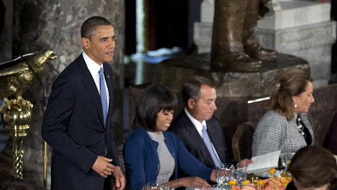 President Barack Obama, from left, with first lady Michelle Obama, Speaker of the House John Boehner, R-Ohio, and his wife Deborah Gunlack, joins members of Congress for a luncheon after his ceremonial swearing-in on Capitol Hill in Washington, Monday, Jan. 21, 2013.   (AP Photo/Manuel Balce Ceneta)