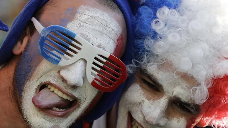 French fans wait for the beginning of the group E World Cup soccer match between Ecuador and France at the Maracana Stadium in Rio de Janeiro, Brazil, Wednesday, June 25, 2014. (AP Photo/Christophe Ena)