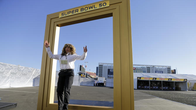 Kim Winkler poses for a picture outside  Levi's Stadium before the NFL Super Bowl 50 football game between the Denver Broncos and the Carolina Panthers,Sunday, Feb. 7, 2016, in Santa Clara, Calif. (AP Photo/Gregory Bull)
