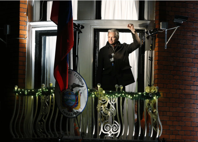 WikiLeaks founder Julian Assange waves to supporters as he prepares to make a statement to the media and supporters at a balcony of the  Ecuadorian Embassy in central London, Thursday, Dec. 20, 2012.