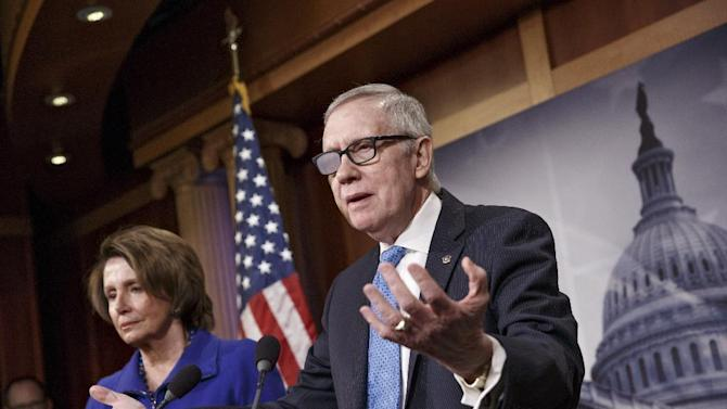 "FILE - In this Feb. 26, 2015 file photo, Senate Minority Leader Harry Reid of Nev., accompanied by House Minority Leader Nancy Pelosi of Calif., gestures during a news conference on Capitol Hill in Washington. Reid is announcing he will not seek re-election to another term. The 75-year-old Reid says in a statement issued by his office Friday that he wants to make sure Democrats regain control of the Senate next year and that it would be ""inappropriate"" for him to soak up campaign resources when he could be focusing on putting the Democrats back in power.  (AP Photo/J. Scott Applewhite)"