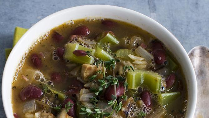 This Jan. 28, 2013 photo shows Mardi Gras red beans and rice soup with andouille sausage is shown served in a bowl in Concord, N.H. (AP Photo/Matthew Mead)