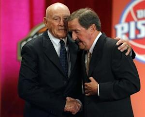 Inductee Herb Magee gets a hug from Hall of Fame Coach Jack Ramsay during the Naismith Memorial Basketball Hall of Fame Class of 2011 Enshrinement Ceremony in Springfield