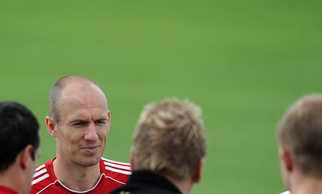 Bayern Munich's Dutch Midfielder Arjen Robben Speaks With Fans  AFP PHOTO / CHRISTOF STACHECHRISTOF STACHE/AFP/ AFP/Getty Images