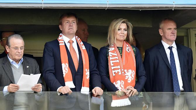 Dutch King Willem-Alexanderd and his wife Queen Maxima wait for the start of the group B World Cup soccer match between Australia and the Netherlands at the Estadio Beira-Rio in Porto Alegre, Brazil, Wednesday, June 18, 2014. (AP Photo/Martin Meissner)