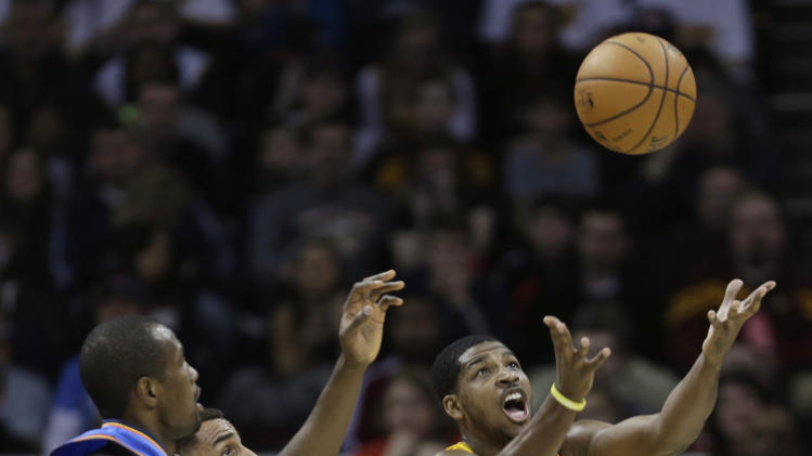 Cleveland Cavaliers' Tristan Thompson, right, tries to grab a rebound ahead of Oklahoma City Thunder's Serge Ibaka, left, from the Republic of Congo, during the first quarter of an NBA basketball game on Saturday, Feb. 2, 2013, in Cleveland. (AP Photo/Tony Dejak)