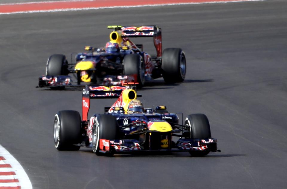 Red Bull driver Sebastian Vettel, of Germany, leads his teammate Red Bull driver Mark Webber, of Australia, into a turn during the Formula One U.S. Grand Prix auto race at the Circuit of the Americas Sunday, Nov. 18, 2012, in Austin, Texas. (AP Photo/David J. Phillip)