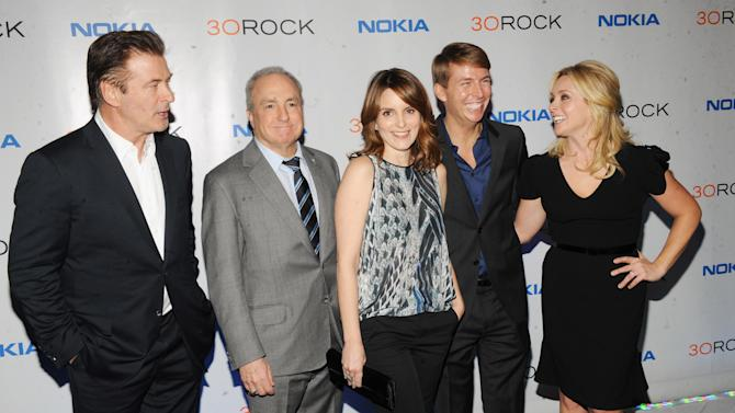 "From left, Alec Baldwin, Lorne Michaels, Tina Fey, Jack McBrayer and Jane Krakowski attend the Nokia ""30 Rock"" wrap party on Thursday, Dec. 20, 2012 in New York. (Photo by Scott Gries for Nokia/AP Images)"